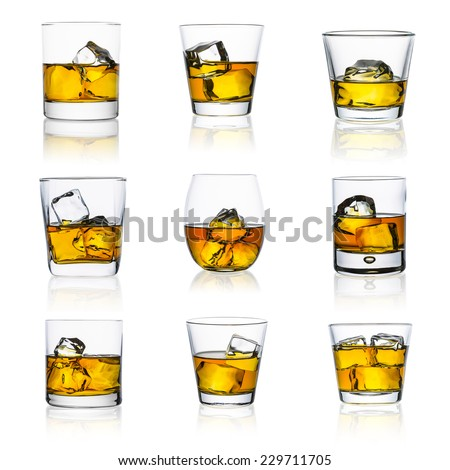 whiskey glasses with ice cubes isolated on white set collage - stock photo