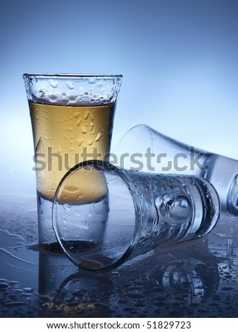 Whiskey in a crystal shot glass - stock photo