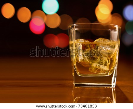 whiskey in a party background - stock photo