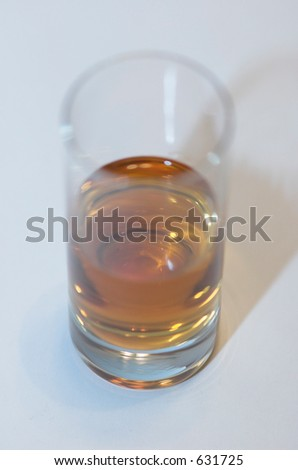 Whiskey in a shot glass - stock photo