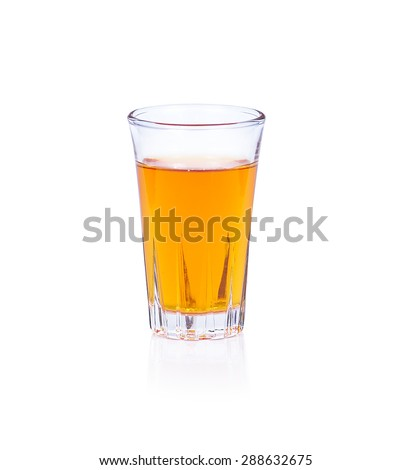 Whiskey in a shot glass isolated on a white background - stock photo