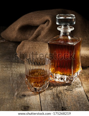 whiskey in glass and bottle - stock photo