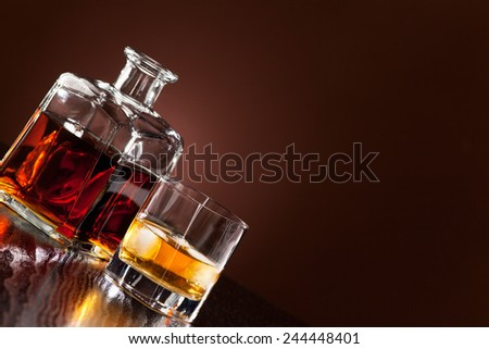 Whiskey in glass from the carafe - stock photo