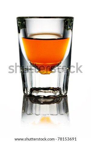 Whiskey in shot glass - stock photo
