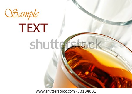 Whiskey in shot glass on white background with copy space.  Macro with shallow dof. - stock photo