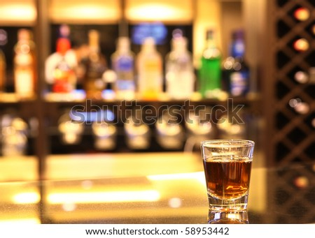 whiskey in the hot shot glass - stock photo