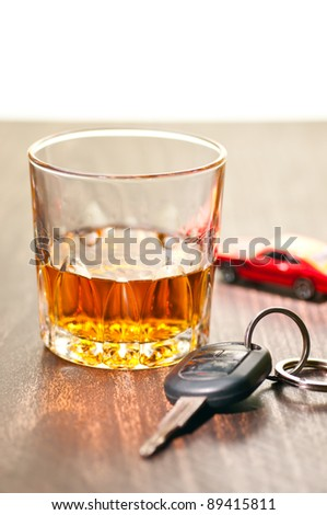 Whiskey neat with a car key indicating don't drink and drive - stock photo