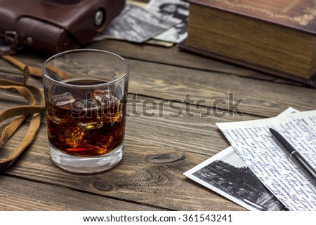 whiskey old camera on a table - stock photo