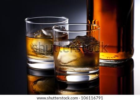 whiskey on black background - stock photo