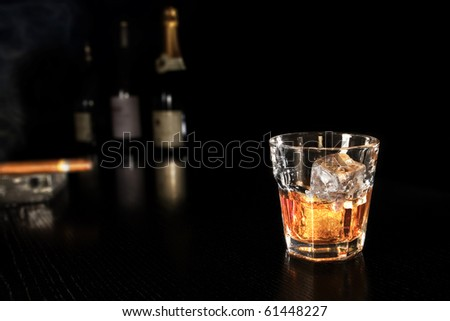 whiskey on the rocks at the bar - stock photo