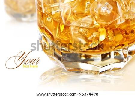 whiskey on the rocks on white background - stock photo