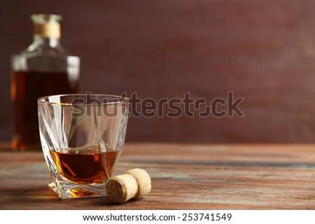 Whiskey on wooden background - stock photo