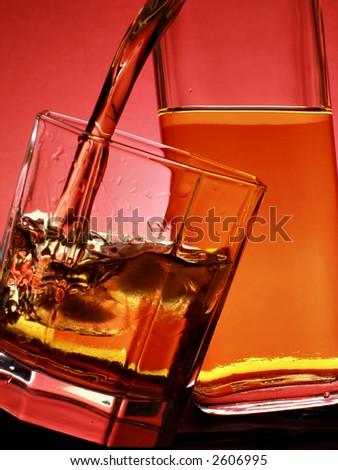 Whiskey pour into glass - stock photo