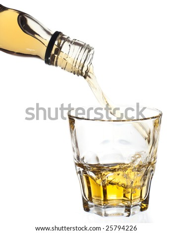Whiskey pouring in glass, isolated, clipping path included - stock photo