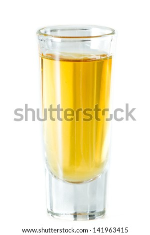 whiskey served in a tall shot glass isolated on a white background