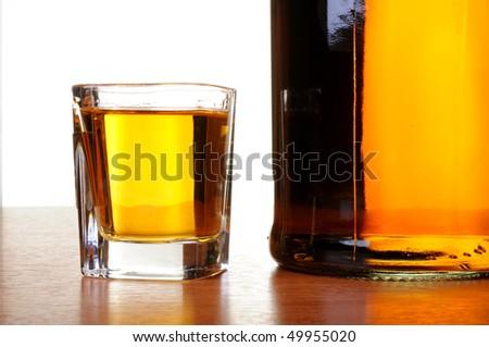 Whiskey shot and bottle - stock photo
