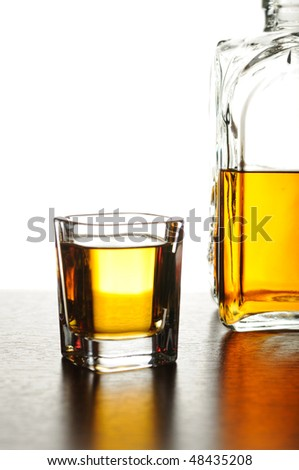 Whiskey shot and decanter - stock photo