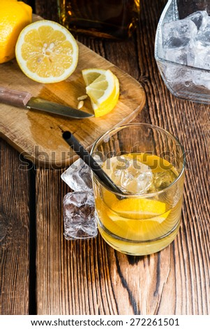 Whiskey Sour with ice cubes (close-up shot) - stock photo