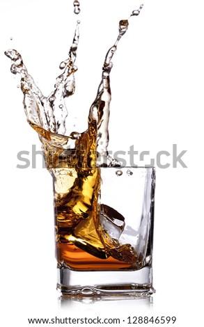 whiskey splash with ice cubes isolated on white - stock photo