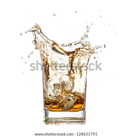 Whiskey splashing out of glass, isolated on white background - stock photo