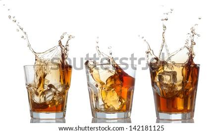 whiskey splashing out of glass isolated on white set - stock photo