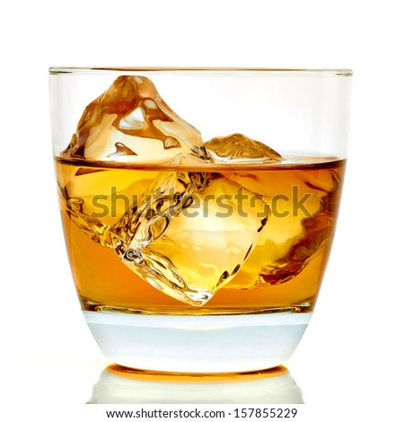 Whiskey with ice cubes in glass with clipping path - stock photo