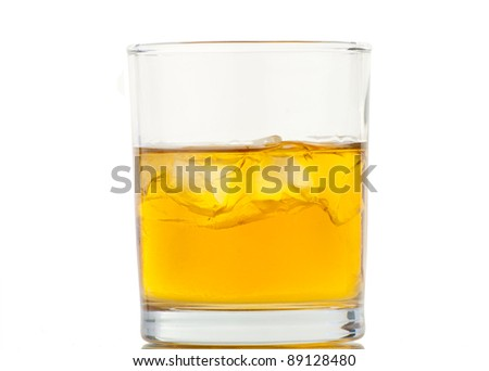 Whiskey with ice cubes. Isolated on white background