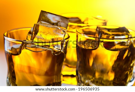 whiskey with ice , focus on a foreground