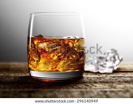 whiskey with ice on a wooden background - stock photo