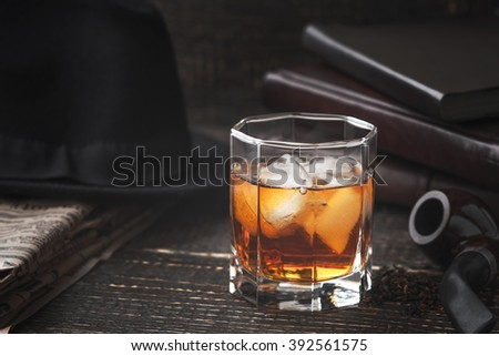 Whiskey with pipe , hat and newspaper horizontal