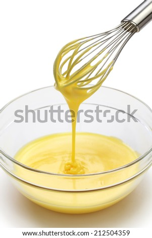 whisking egg yolks and sugar in a bowl - stock photo