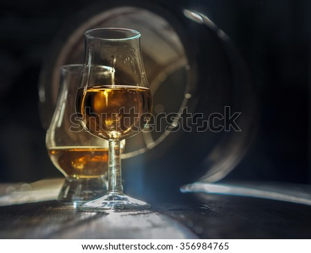 Whisky and brandy and oak barrel - stock photo