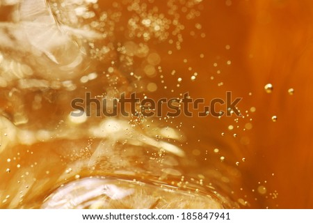 whisky and ice in glass, bubble float, background. - stock photo