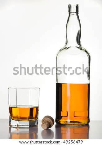 Whisky Bottle and Glass - stock photo