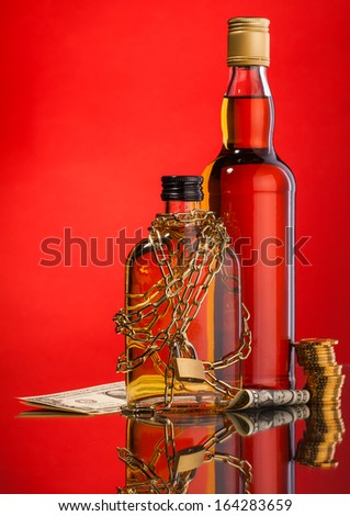 whisky bottles and money composition
