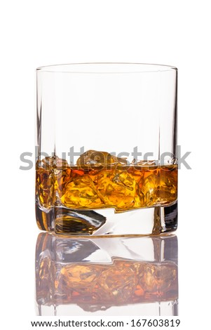 whisky glass with ice - stock photo
