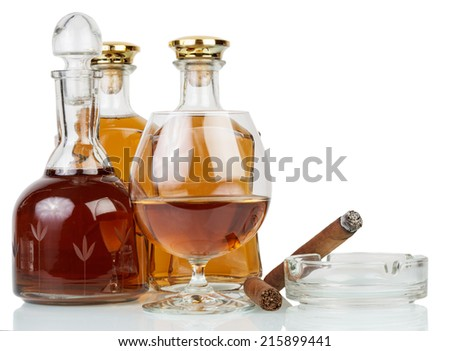 Whisky in glasses and cigar isolated on white - stock photo