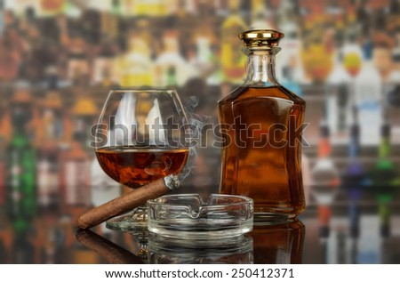 Whisky in glasses and smoking cigar on bar background - stock photo