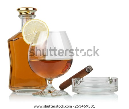 Whisky in glasses and smoking cigar on white background - stock photo
