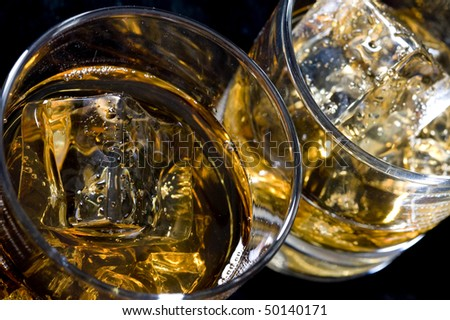 Whisky on the rock. Alcohol drink and ice - stock photo