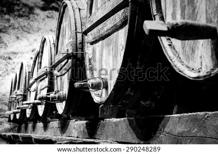 Whisky or wine barrels in black and white - stock photo
