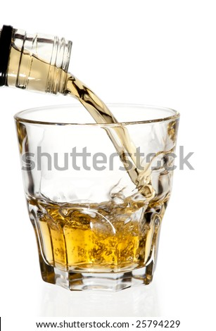 Whisky pouring in glass, isolated with clipping path - stock photo