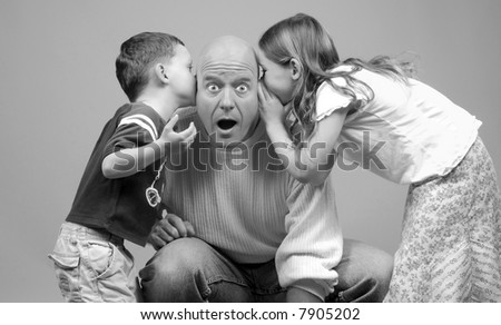 Whispered Secrets Being Told to Dad by Kids - stock photo