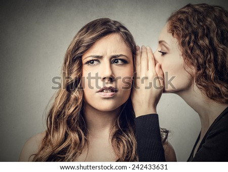 Whispering a secret  - stock photo