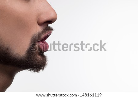 Whispering . Man whispering to gossip isolated on a white background. - stock photo