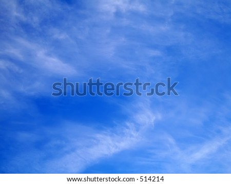 Whispy clouds in a blue sky - stock photo