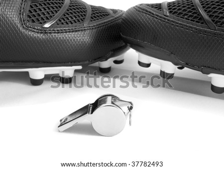 Whistle and football boots isolated