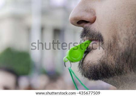 Whistle in the mouth close up - stock photo