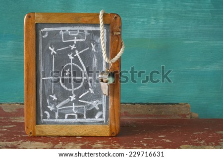whistle of a soccer / football referee and tactics blackboard, free copy space  - stock photo