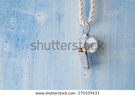 whistle of a soccer or football referee, free copy space - stock photo